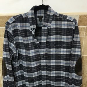 Blue flannel with brown elbow patches